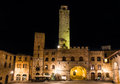 Torre rognosa in san gimignano tuscany palazzo vecchio del podesta with its stand piazza del duomo italy Royalty Free Stock Photography