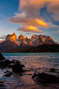Torres del paine sunrise vertical composition of over with shore of lake pehoe in foreground Royalty Free Stock Images
