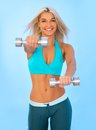 Torso of a young fit woman lifting dumbbells Royalty Free Stock Photo