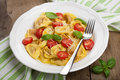 Tortellini with cheese and tomatoes Stock Photo