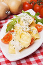 Tortellini pasta with cheese sauce and tomato Royalty Free Stock Photo