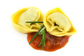 Tortelloni with tomato sauce Stock Photos