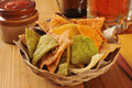 Tortilla chips and beer a basket of corn with salsa a mug of Royalty Free Stock Image
