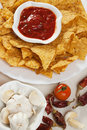 Tortilla chips with hot salsa dip Stock Photos