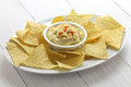 Tortilla chips with hummus dip for super bowl Royalty Free Stock Image