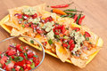 Tortilla chips with melted cheddar beans hot salsa and guacamole Royalty Free Stock Photo