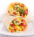 Tortilla wrap with vegetables closeup on Stock Photography