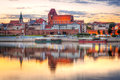 Torun old town reflected in vistula river at sunset poland Royalty Free Stock Images
