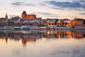 Torun old town reflected in vistula river at sunset poland Stock Photography