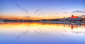 Torun old town reflected in vistula river at sunset poland Royalty Free Stock Photography