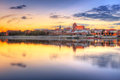 Torun old town at sunset reflected in vistula river poland Stock Photo