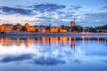 Torun old town at sunset reflected in vistula river poland Stock Photos