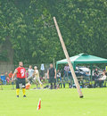 Tossing the caber. Royalty Free Stock Images
