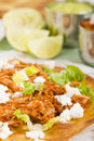 Tostadas mexican crispy corn tortilla topped with chicken tinga lettuce and cotija cheese served with pico de gallo guacamole and Royalty Free Stock Photo
