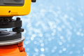 The total station the geodetic and topography measuring tool circular bokeh background of light shining on river Stock Photo