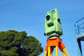 Total station surveying instrument against blue sky Royalty Free Stock Images