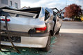 Totaled motor vehicle after a smash hatchback viewed from behind showing flattened roof and shattered windows as though it Royalty Free Stock Photo