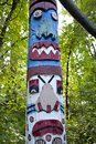 Totem Pole in the Forest Stock Images