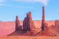 Totem pole rock formation in monument valley called with dancing warriors Stock Images