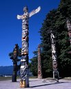 Totem poles stanley park bancouver elaborately painted in vancouver british columbia canada Royalty Free Stock Photos