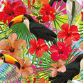 Toucan leaves and flowers seamless pattern colorful motley backg