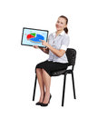 Touch pad with graph woman sitting on chair Royalty Free Stock Photo
