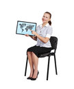Touch pad with world map woman sitting on chair Stock Photos