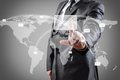 Touch screen businessman pushing mail on world map on a interface Royalty Free Stock Photos
