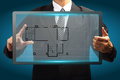 Touch screen interface house blueprints in the hands of businessmen Royalty Free Stock Photography