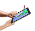 Touch screen tablet  in hand With graph Royalty Free Stock Photo