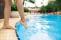 Touching water female legs with her tiptoes Royalty Free Stock Photography