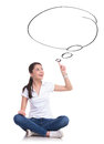 Touching your dreams casual young woman sitting with legs crossed and her from a speech bubble isolated on white background Royalty Free Stock Photography