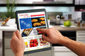 Touchpad PC Shows A Cooking Website Royalty Free Stock Photo