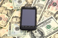 Touchscreen mobile phone and dollars Royalty Free Stock Photo