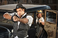 Tough gangster aiming gun s vintage gangsters outside guns from car Stock Image