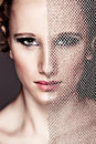 Tough girl closing face with textile. Retouched Royalty Free Stock Photography