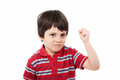 Tough kid holding his fist clenched looking mean Royalty Free Stock Photography