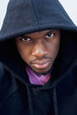 Tough looking black guy with hood sweatshirt Royalty Free Stock Photo