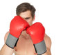Tough man wearing red boxing gloves in guard position on white background Royalty Free Stock Photo