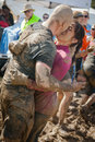 Tough mudder muddy engagment racers get engaged at the finish line of the competition in mansfield ohio on april this race was Stock Images