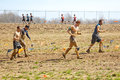 Tough mudder muddy racers group of running between obsticles at the competition in mansfield ohio on april this race was designed Stock Photography
