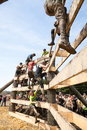 Tough mudder racers climbing over an obstacle male and female at the competition in mansfield ohio on april this race was designed Royalty Free Stock Photo