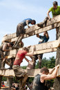 Tough mudder racers climbing the wall male and female over an obstacle at competition in mansfield ohio on april this race was Royalty Free Stock Image