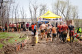 Tough mudder racers at the first aid station teams of moving through competition in mansfield ohio on april a group running Stock Photography