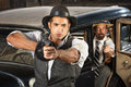Tough s era gangsters with weapons vintage by car Royalty Free Stock Photos