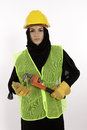 Tough work a young arab woman dressed for construction Stock Images