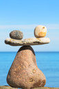 Toughness symbol of scales is made of pebbles on the seashore Stock Photo