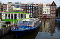 Tour boat waiting tourist near amsterdam central train station Stock Photos
