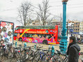 Tour bus on the street in amsterdam netherlands february Royalty Free Stock Photo