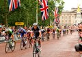 Tour de france in london uk – july cyclists arrive at the mall under heavy rain approaching the finish line of the third stage Royalty Free Stock Photo